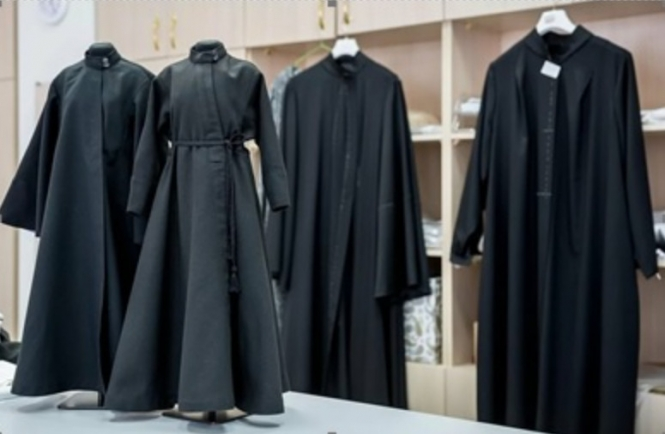 Daily vestments of a priest, a cassock and a wimp